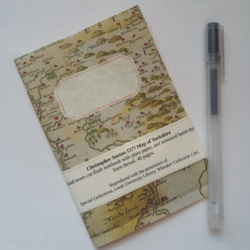 A notebook with an old map image on the cover
