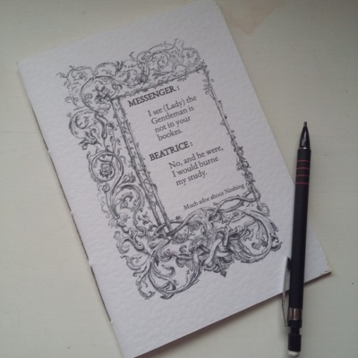 An A5 notebook with a Shakespear quote on the cover.