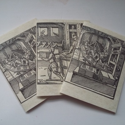 Three pamphlets with woodcuts showing a bookbinder, printer, and paper maker.