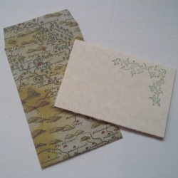 Envelope with map image on and hand stamped card.