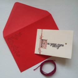 Folded letter paper, string, and red envelope