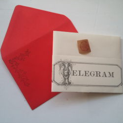 A folder telegram with envelope and sticker