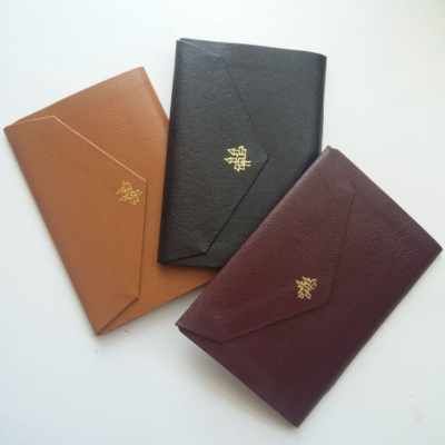 Three Notebooks with a gold tooled city on.