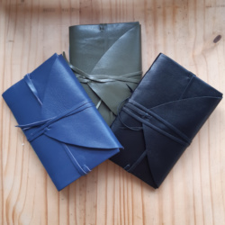 Three leather notebooks with ties