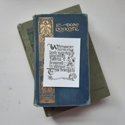 Image of a bookplate resting on top of two books