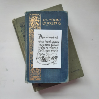 An image of a bookplate resting on two books