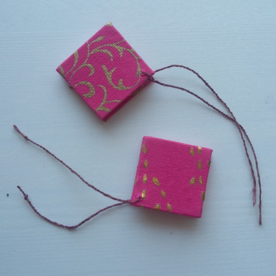 A picture of a pair of pink starbooks