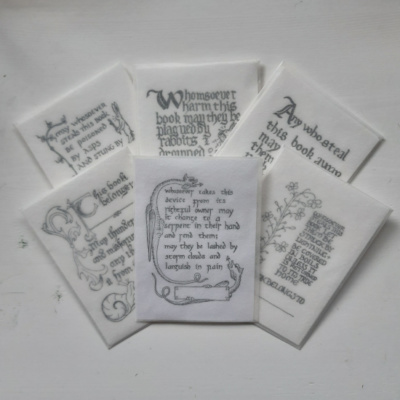 An image of 5 packets of bookplates and one sticker