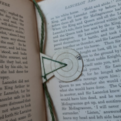 A bookmark with a revolving disc showing roman numerals